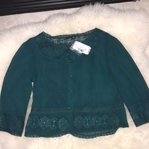 Emerald green embroidered blouse
